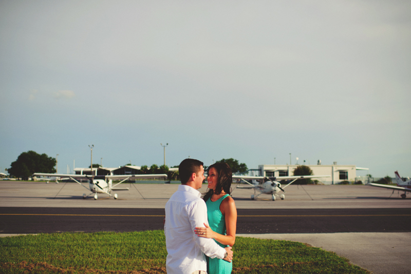 romantic airport engagement session: airplane backdrop