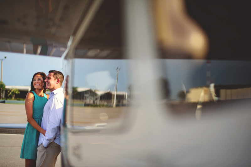romantic airport engagement session: smiling at airport