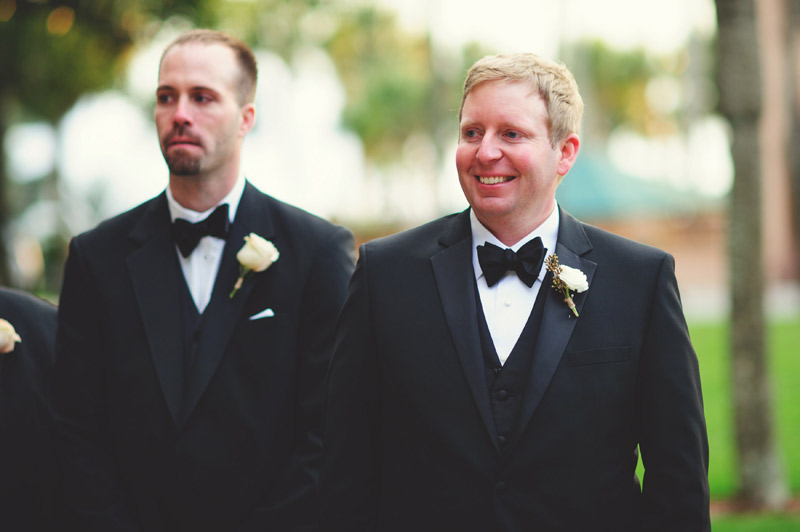 ringling museum wedding: groom smiling as bride walks down aisle