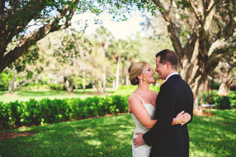 naples backyard beach wedding: bride and groom smiling under banyan tree