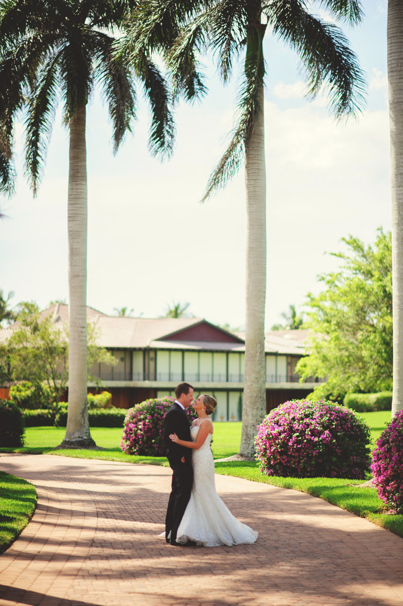 naples backyard beach wedding: bride and groom standing on driveway