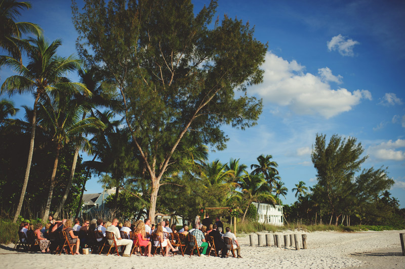 naples backyard beach wedding: ceremony with guests seated