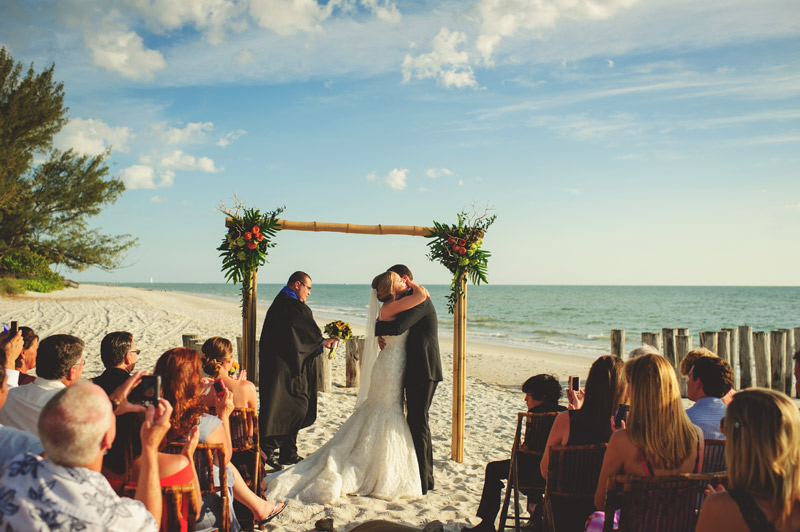 naples backyard beach wedding: bride and groom hug