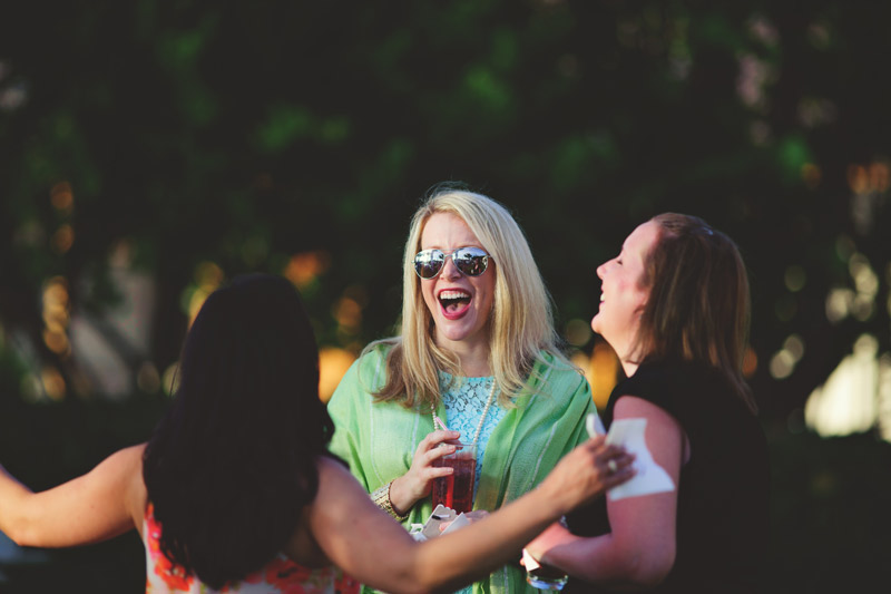 naples backyard beach wedding: cocktail hour laughing candids