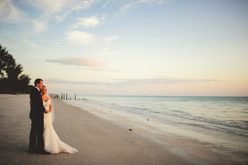 naples backyard beach wedding: beach portrait holding hands