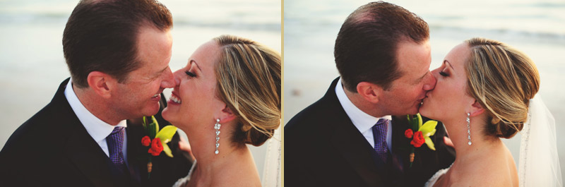 naples backyard beach wedding: bride and groom kissing near ocean