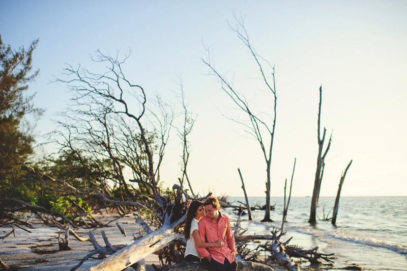 romantic driftwood beach engagement photographer
