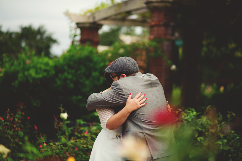 winter park farmers market wedding: bride and groom hugging