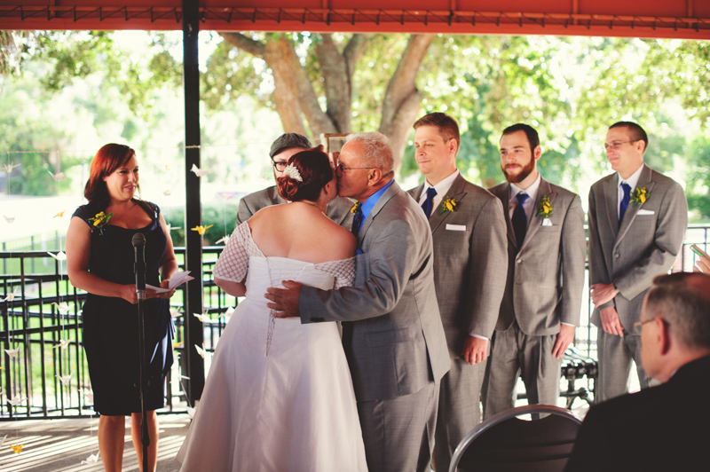 winter park farmers market wedding: father kissing bride