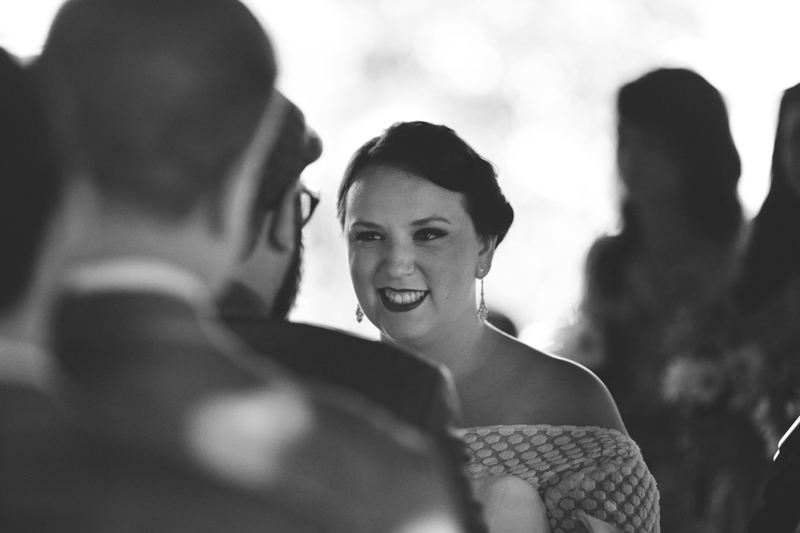 winter park farmers market wedding: bride smiling during vows