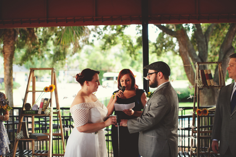 winter park farmers market wedding: bride putting ring on groom