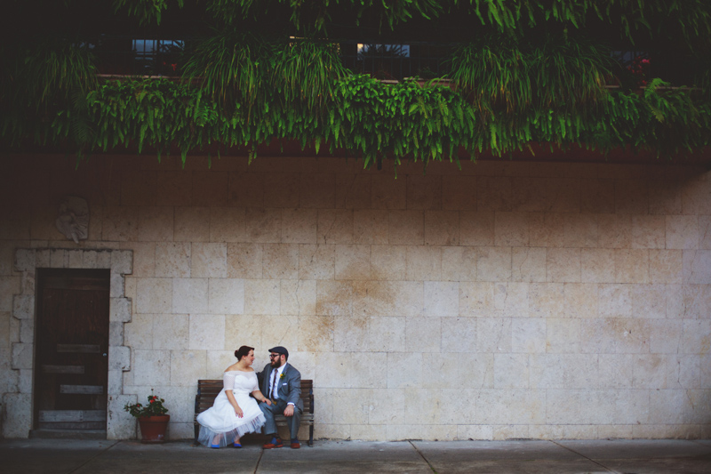 winter park farmers market wedding: sitting on bench