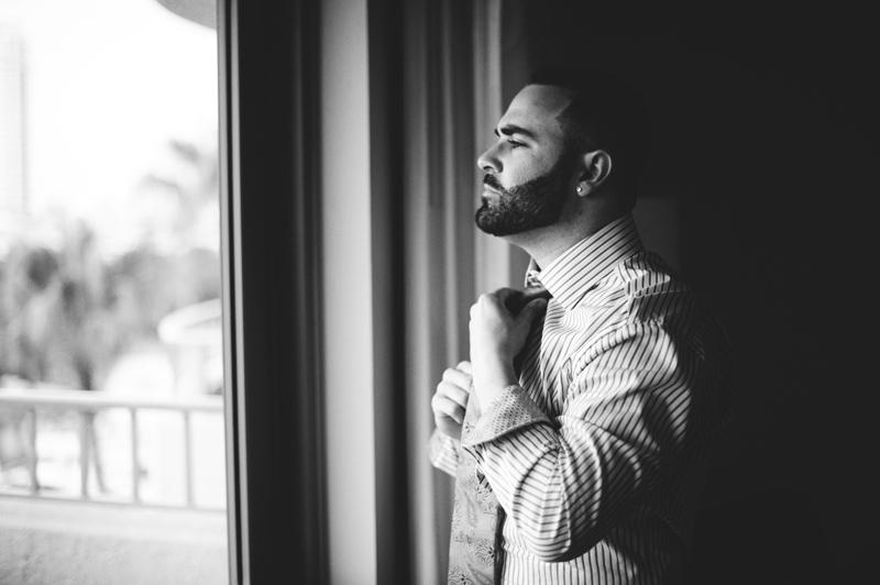 st pete elopement:  groom fixing tie