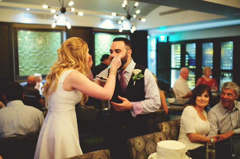 st pete elopement:  cake feeding