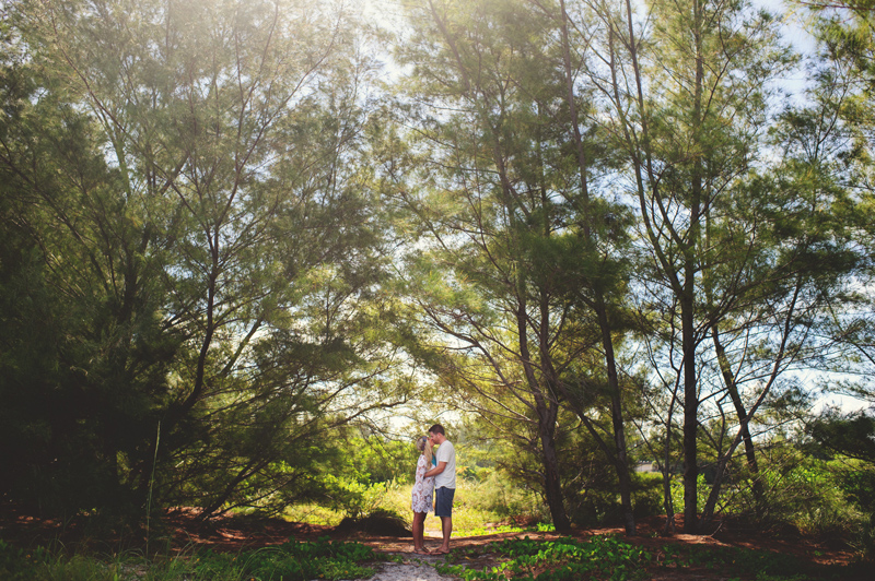 boho beach engagement photos: couple in woods