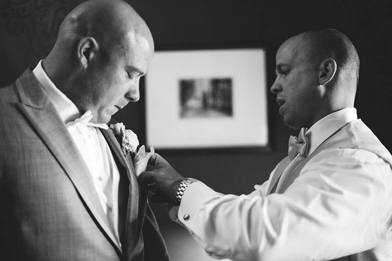 romantic sundy house wedding: best man helping with getting ready