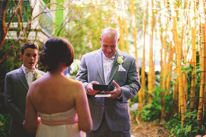 romantic sundy house wedding: groom opening gift