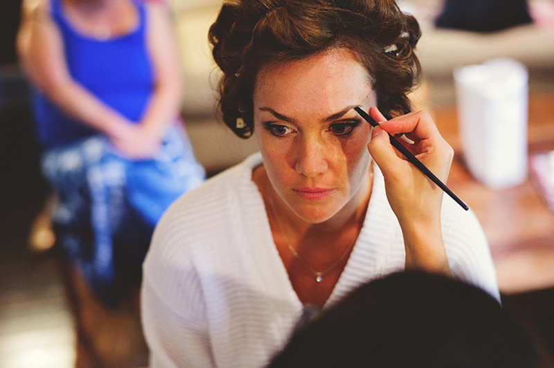 romantic sundy house wedding: bride getting makeup done