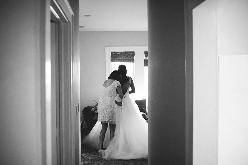 romantic sundy house wedding: bride getting in dress