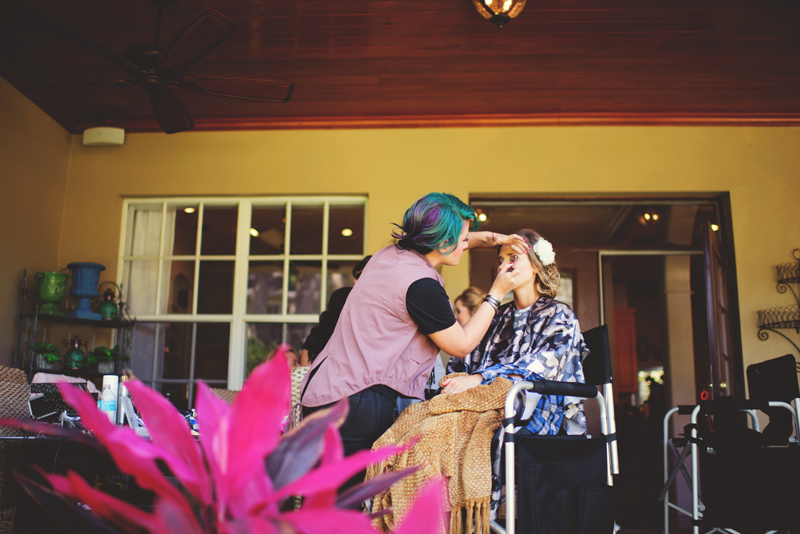 backyard wedding tampa: bride getting makeup done