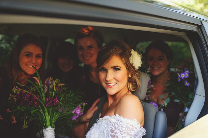 backyard wedding tampa: bridesmaids in car