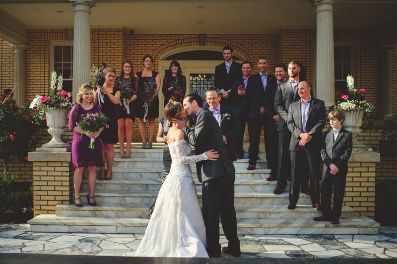 backyard wedding tampa: bride and groom first kiss