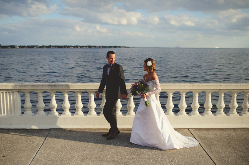 backyard wedding tampa: bride and groom walking on bayshore blvd