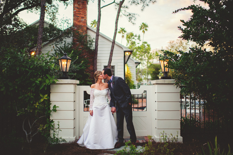 backyard tampa wedding: bride and groom kissing