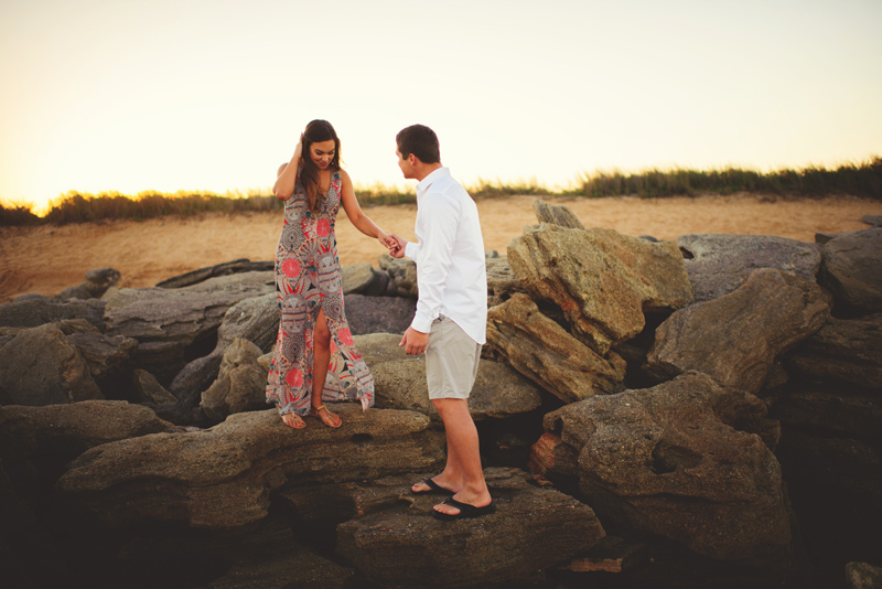 washington oaks state park engagement: groom helping bride
