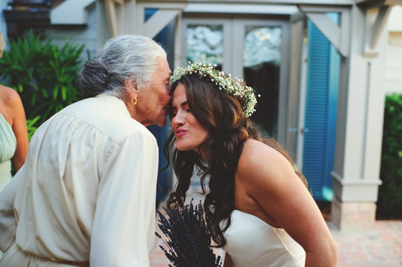 boho backyard wedding naples: grandma kissing bride