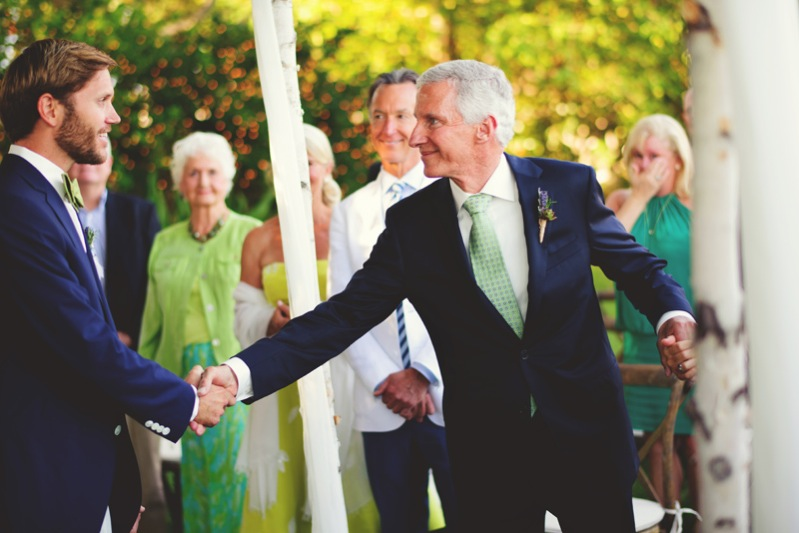 boho backyard wedding naples: father of bride shaking grooms hand