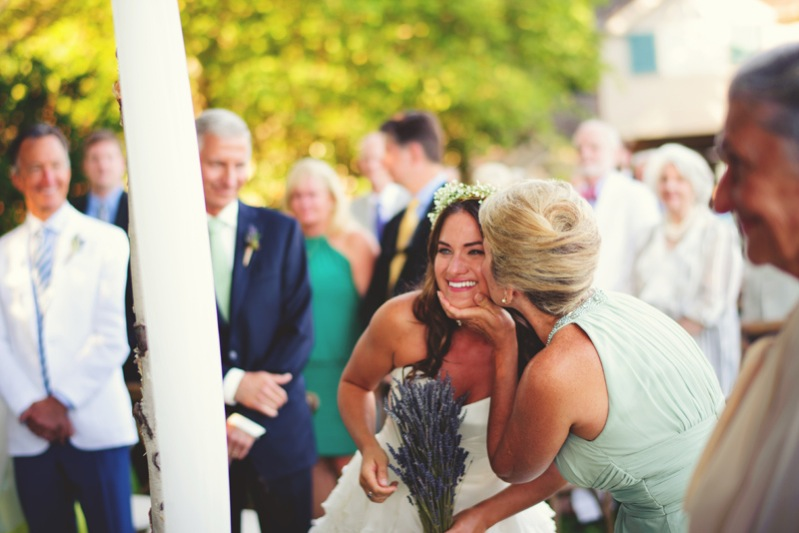 boho backyard wedding naples: mother kissing bride