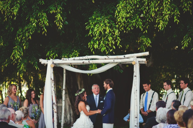 boho backyard wedding naples: bride and groom holding hands
