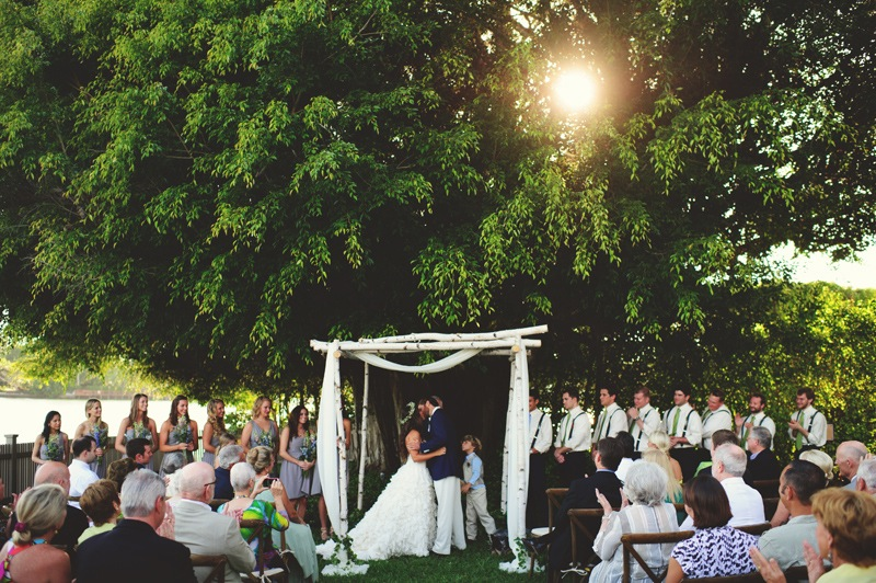 boho backyard wedding naples: first kiss