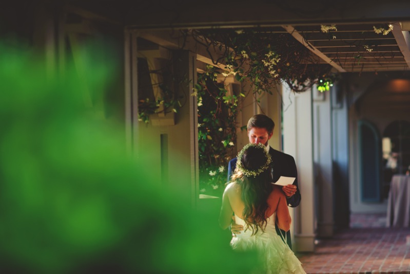 boho backyard wedding naples: reading each other vows