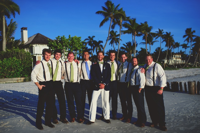boho backyard wedding naples: groomsmen on the beach