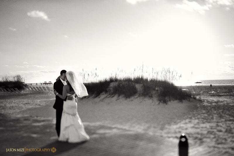 sandpearl wedding: bride and groom boardwalk