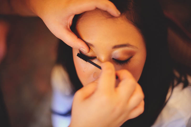 powel crosley estate wedding: bride getting make up done