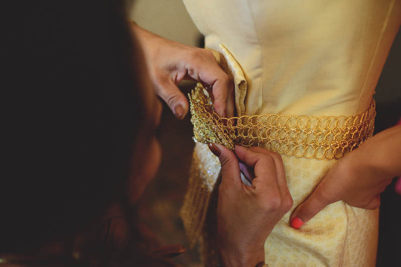 powel crosley estate wedding: bride getting ready for Thai ceremony