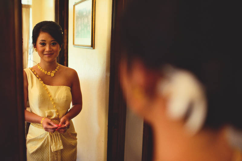 thai bride looking into mirror