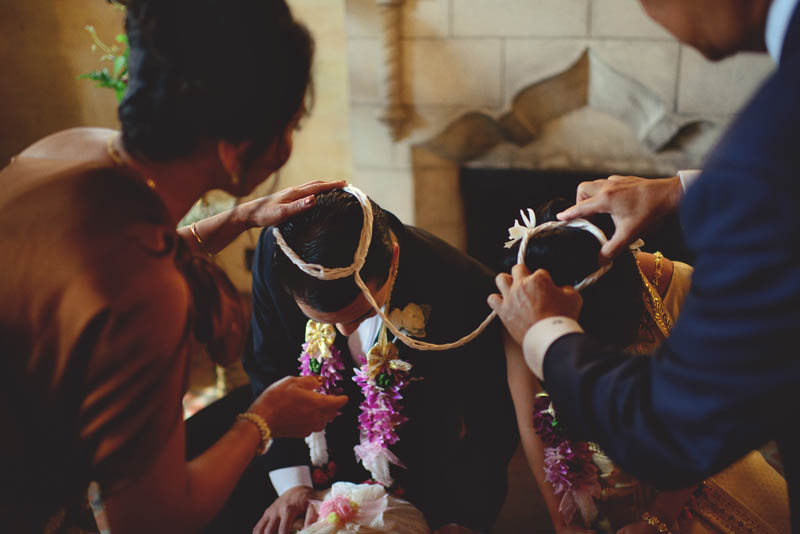 powel crosley estate wedding: thai ceremony tying ribbon
