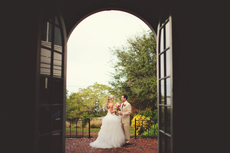 bride and groom through door
