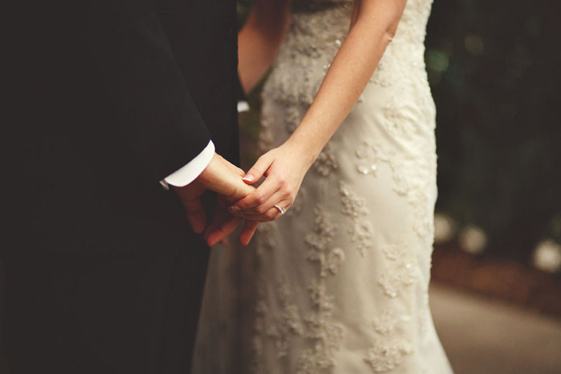 House of Blues Wedding: holding hands