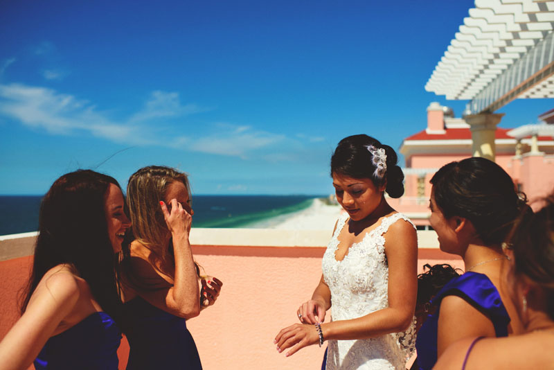 bride getting dressed on balcony
