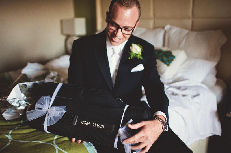 vinoy renaissance wedding: groom opening present