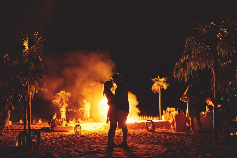 Harbour Island rehearsal dinner: bonfire silhouette