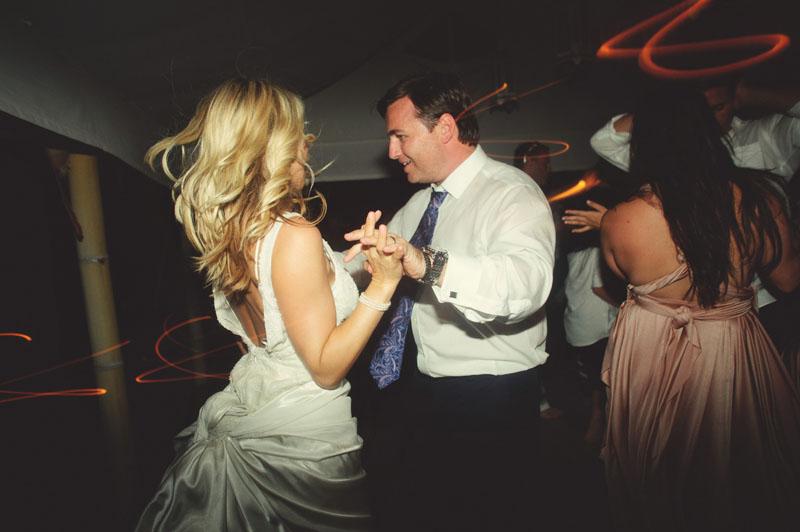 Harbour Island Wedding: Bride and groom fun dancing