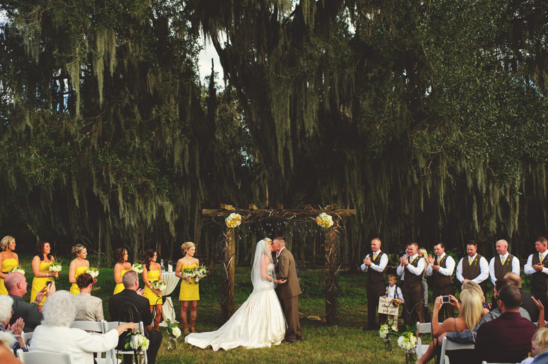 plant city farm wedding: first kiss