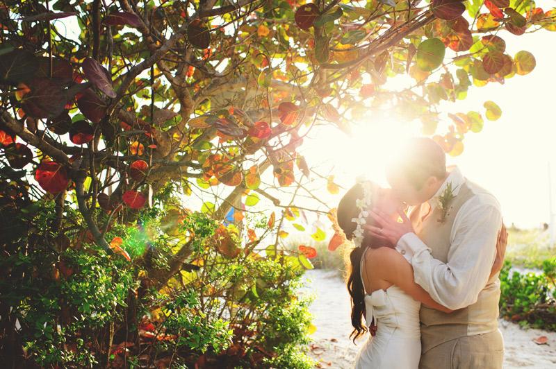 anna maria island wedding: bride and groom kissing