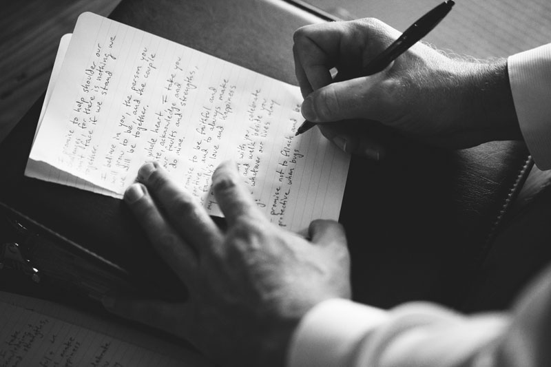 postcard inn holiday isles wedding: groom writing vows